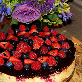 Very Berry Cheesecake   by Robert Cohene by Ivan Cohene - Food & Drink Cooking & Baking ( cheesecake, cake, blueberry, red, blue, cheese, round, dairy, homemade, strawberry, dessert )