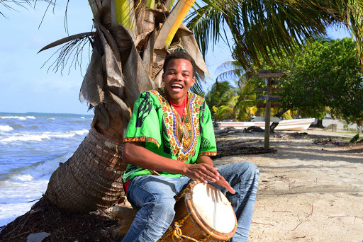 Belize-drum-beach.jpg - Drum playing on a beach in Belize.