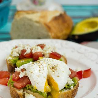 Avocado Tomato and Feta Toast with Poached Eggs