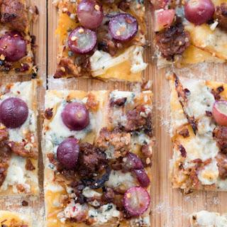 Sausage, Grape, and Gorgonzola Flatbread Pizza.