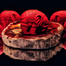 by Dave Walters - Artistic Objects Still Life ( red, elephants carved )