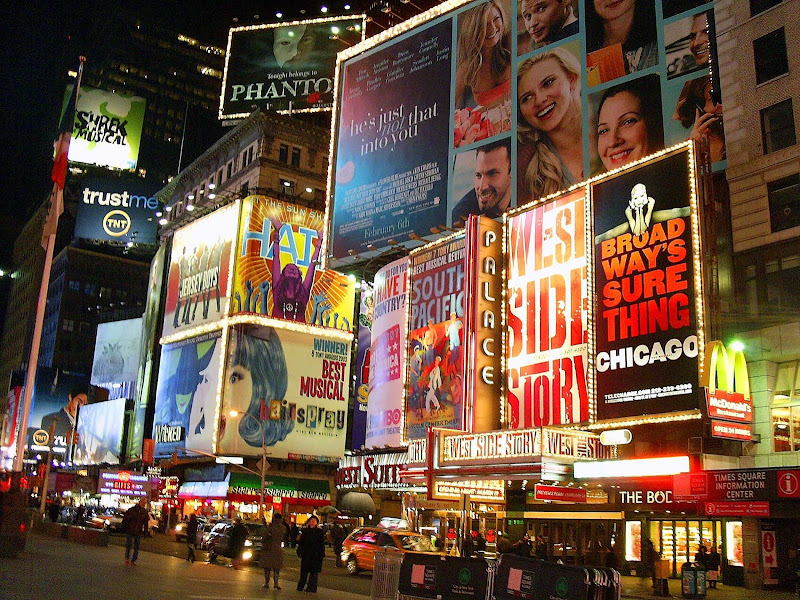 The lights of Broadway in New York at night.