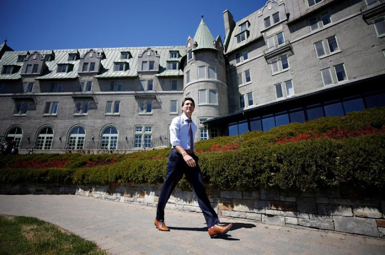 Canada's Prime Minister Justin Trudeau walks outside the Manoir Richelieu, site of the G7 leaders' summit in Quebec's Charlevoix region. Picture: REUTERS/Chris Wattie -