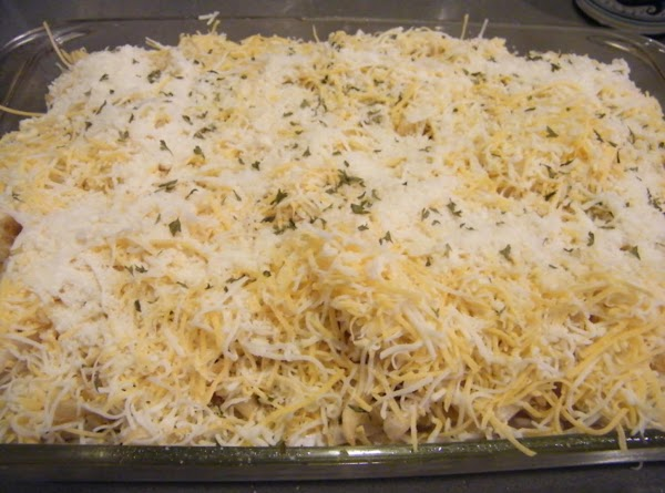 Top with grated cheese and parmesan.  Sprinkle with parsely.