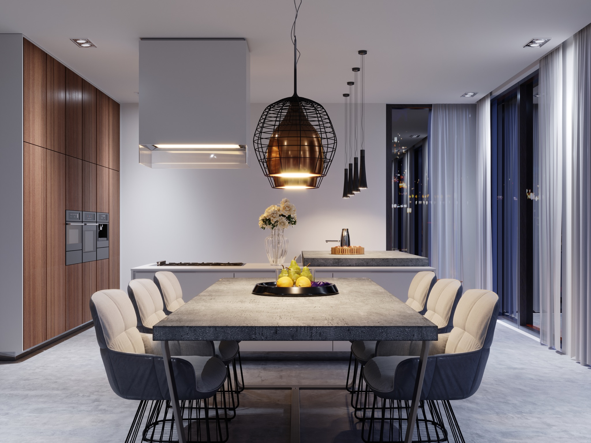 Concrete dining table and kitchen countertop in modern open kitchen featuring concrete floors, copper and black metal pendant lighting and sleek woodgrain modern cabinetry