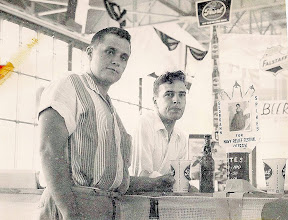 """Photo: Cliff Bosworth & Ted Craft, TD's ('55-58) in the Ground Training Dept. enjoy a couple of cool ones in a hanger at a base """"Open House"""" for the town folks."""