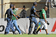 Police were called to control unruly Celtic fans who threw missiles before invading the pitch in a match against Cape Town City at the Dr Molemela Stadium on Sunday.