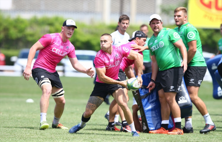 Cameron Wright passes the ball during the Cell C Sharks training session at Growthpoint Kings Park on February 12, 2018 in Durban, South Africa.