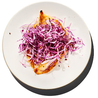 15-Minute Chicken Paillards with Red Cabbage and Onion Slaw.