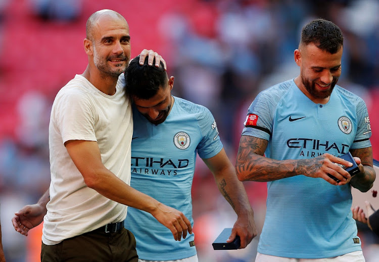 Manchester City manager Pep Guardiola celebrates winning the Community Shield with Manchester City's Nicolas Otamendi and Sergio Aguero after the match at Wembley Stadium, London, August 5 2018. Picture: REUTERS/JOHN SIBLEY