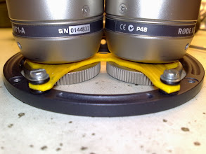 Photo: The fastening nut may not touch the carrying ring.  Both mics must float freely on the yellow suspension.