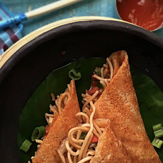 Mumbai Special Schezwan Dosa (Dosa With Chowmein Noodle Stuffing)