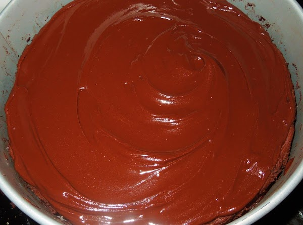 Glaze the cake: Melt the chocolate and butter in the microwave or in a medium...