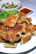 "Photo: savory meat-stuffed ""mataba"" roti served with cucumber relish and sweet-and-sour chilli sauce"