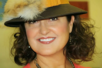 Photo: <KAPELUXE> Unique-Chique Hats by Luba Bilash ART & ADORNMENT  Chocolate brown wool felt fedora style base, pleated marigold grosgrain ribbon, red fox tail, 360 degree possibilities. Can also be worn on an angle. Size L - 56 cm/22 in $90 SOLD