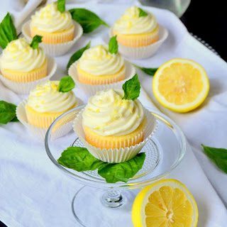 Lemon Cupcakes with Basil Whipped Cream Frosting.