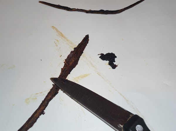 Cut in half and scrape vanilla bean seeds out of each half. Use the...