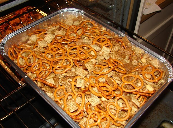 I use aluminum roasting pans, two of them. Half of the mixture will fit...