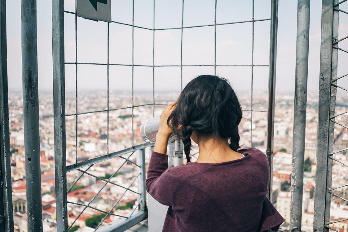 Woman Looking on Telescope