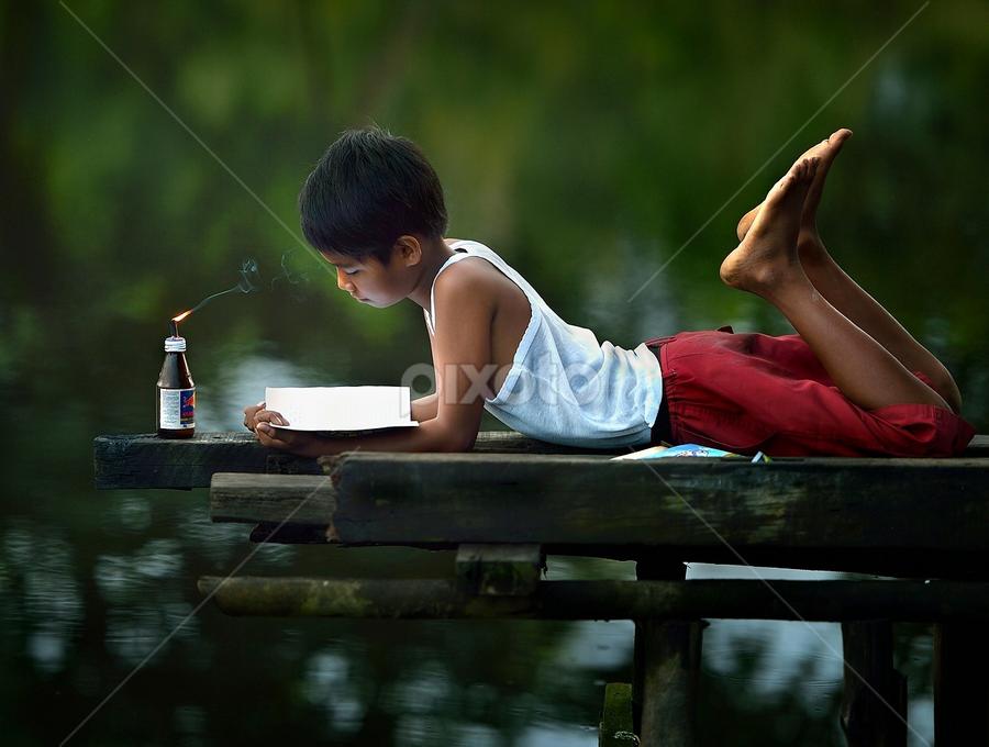 a d i t by Dody Herawan - Babies & Children Child Portraits ( reading, mood, study, boy, portrait, human )