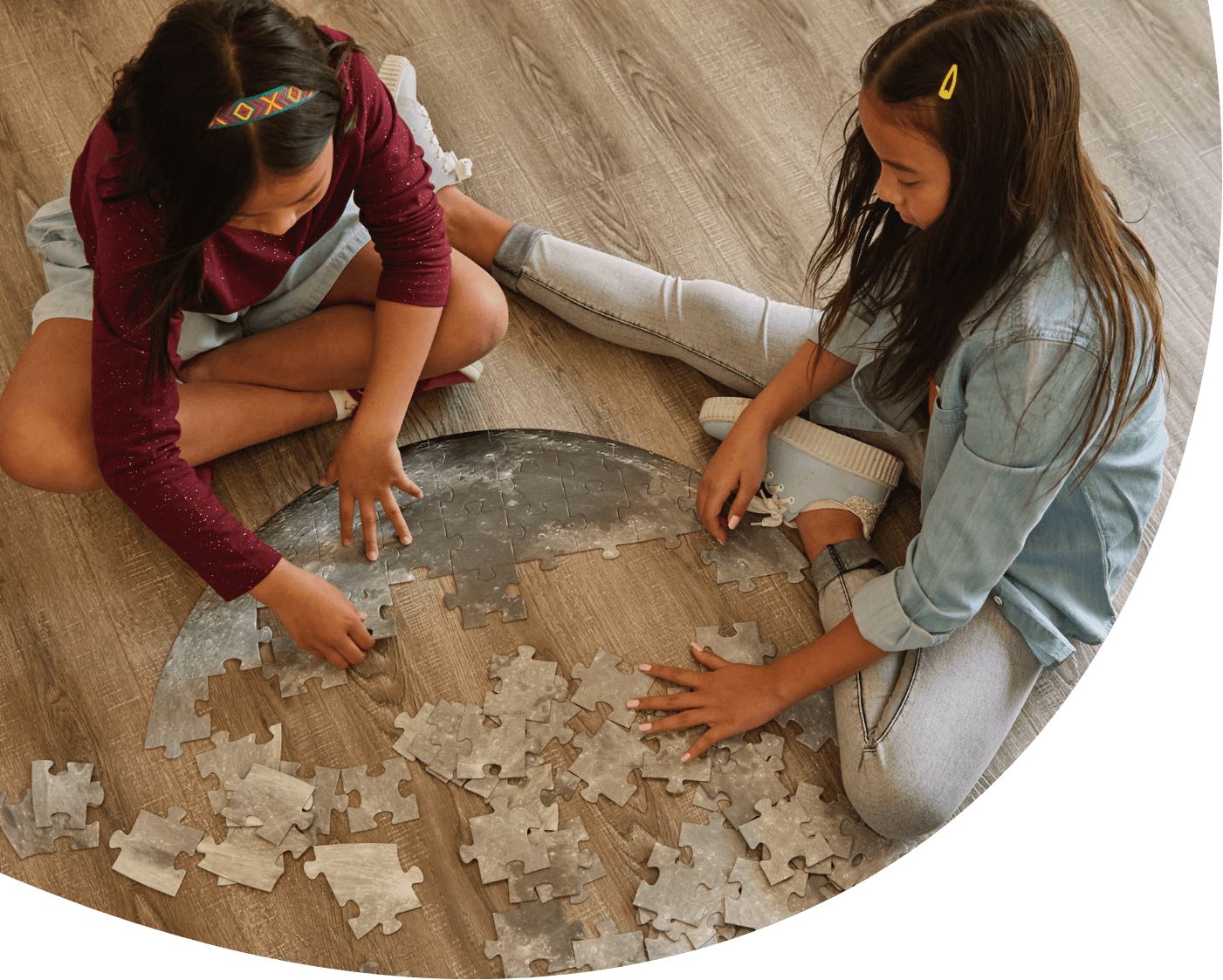 Sisters assembling a puzzle