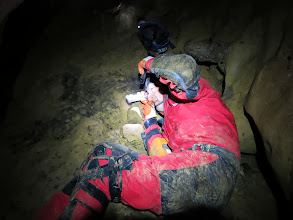 Photo: Brian taking a survey shot in Church Cave