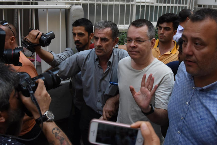 US pastor Andrew Brunson reacts as he arrives at his home after being released from the prison in Izmir, Turkey, in this July 25 2018 file photo. Picture: DEMIROREN NEWS AGENCY/DHA VIA REUTERS