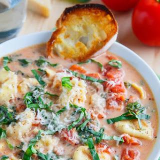 Creamy Parmesan Tomato and Spinach Tortellini Soup.