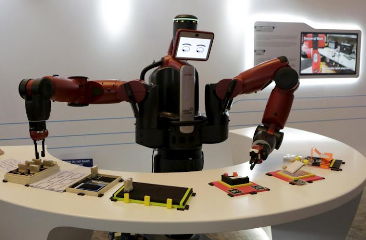 A Baxter robot of Rethink Robotics picks up a business card as it performs during a display at the World Economic Forum (WEF), in China's port city Dalian, Liaoning province, China, September 9, 2015. Picture: REUTERS/Jason Lee