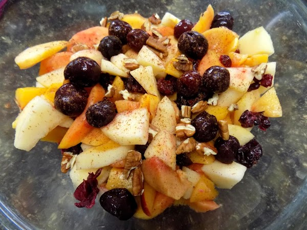 Into a mixing bowl, cut peaches, nectarines and apples into pieces. Add cherries, pecans,...