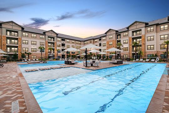 Adley at Gleannloch Apartments Exterior Pool Shot at dusk