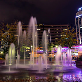 Fountain at The Grove by Rachaelle Larsen - City,  Street & Park  Night ( long exposure fountain, the grove, fountain, bank buildings, downtown boise )