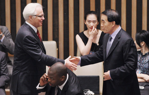 Photo: PHOTO OF THE DAY - New York, NY - July 19: Chinese Ambassador to the United Nations Li Baodong (R) and Russian Ambassador to the United Nations Vitaly Churkin shake hands before a vote on a new U.N. Security Council resolution on Syria at U.N. headquarters on July 19, 2012 in New York City. The resolution aimed at ending the violence with non-military sanctions in Syria failed to gather enough votes to pass with Russia and China vetoing. Source: Getty Images/Photobank