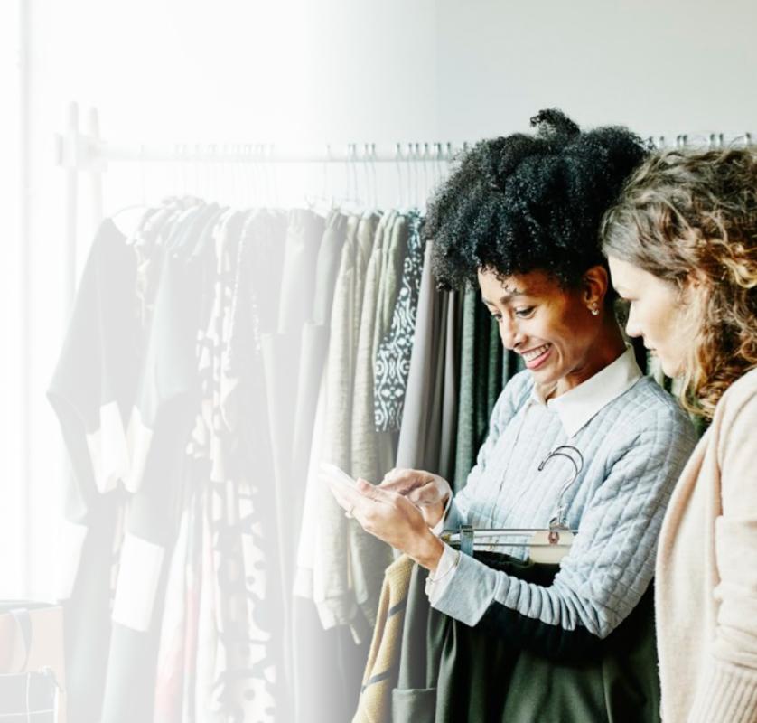 Two women at dress shop