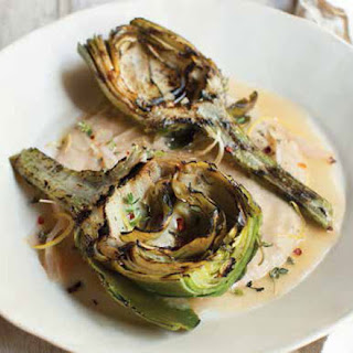 Grilled Artichokes with Garlic Broth and White Bean Brandade