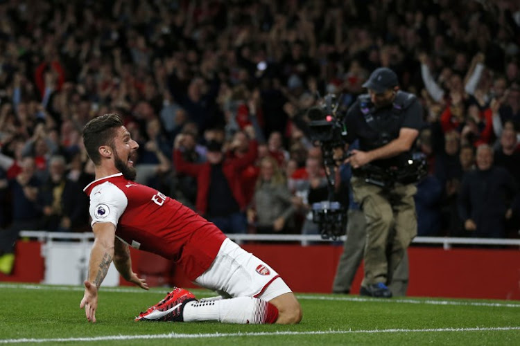 Arsenal's French striker Olivier Giroud celebrates scoring Arsenal's fourth goal during the English Premier League football match between Arsenal and Leicester City at the Emirates Stadium in London on August 11, 2017.
