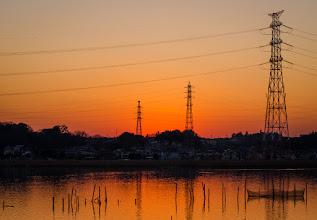 Photo: A warm orange sunset behind the power lines and trees at Lake Teganuma in Kashiwa, Chiba Prefecture
