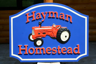 Photo: Painted Wood Farm Sign, more carved signs at http://www.nicecarvings.com