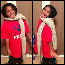 Photo: Kaleya models the scarf she and her brothers made as a present