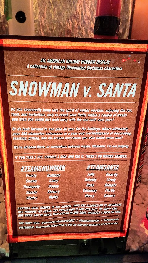 Snowman vs Santa - are you #TeamSnowman or #TeamSanta #illuminatedpdxmas2017 at the All American Holiday Window Display