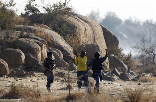 Police on scene following the shootout at Marikana mine. Picture: REUTERS