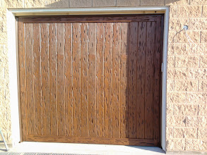 "Photo: Wood Free Garage Doors. Here is a Pecky Cypress wood with a factory ""Walnut"" paint job."