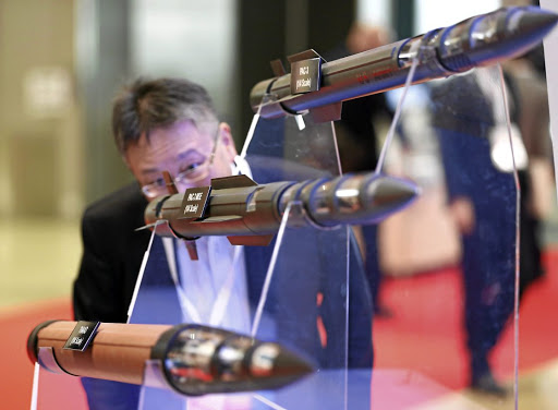 Reassuring result:  A man looks at models of Lockheed Martin's PAC-3, PAC-3 MSE and THAAD missiles at the Japan Aerospace 2016 air show in Tokyo, Japan. Picture: REUTERS