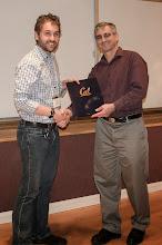 Photo: Sam Coogan accepting the Leon O. Chua Award.