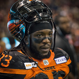 Offensive Linebacker by Garry Dosa - People Professional People ( orange, sports, players, helmet, black, indoors, cfl, stadium, football, portrait, people )