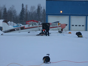 Photo: Putting the planes to bed every night is a team effort