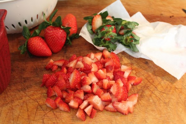 Chop the strawberries into small dices, leaving several to cut in half for garnish.
