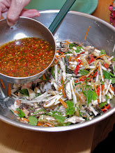 Photo: adding the hot-and-sour dressing