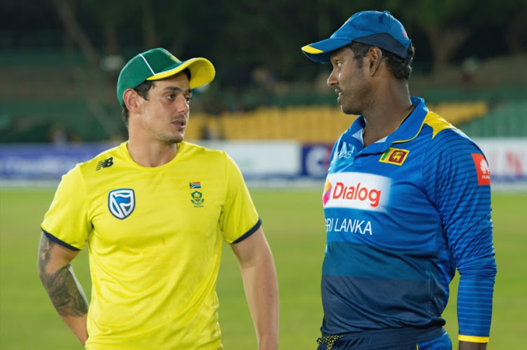 Quinton de Kock (L) of South Africa having a chat with Sri Lanka captain Angelo Mathews after the post-match presentation in the 2nd ODI at Rangiri Dambulla International Stadium on August 01, 2018 in Dambulla, Sri Lanka.