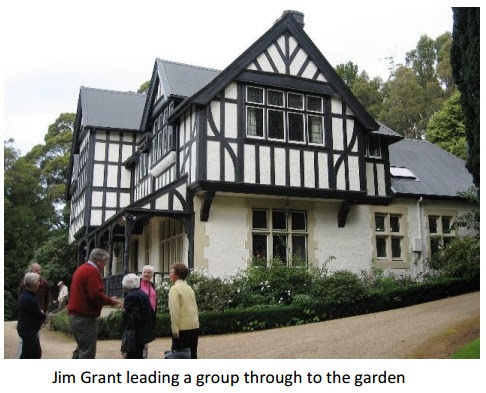 Jim Grant leading a group through to the garden